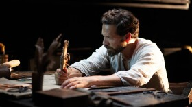 Ferdinand Magellan (Markus Klauk) in his captain's cabin looking over the maps.