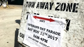 """""""Tow away zone"""" parking sign for the San Diego Veterans Day Parade sits on Harbor Drive downtown, Nov. 10, 2017."""