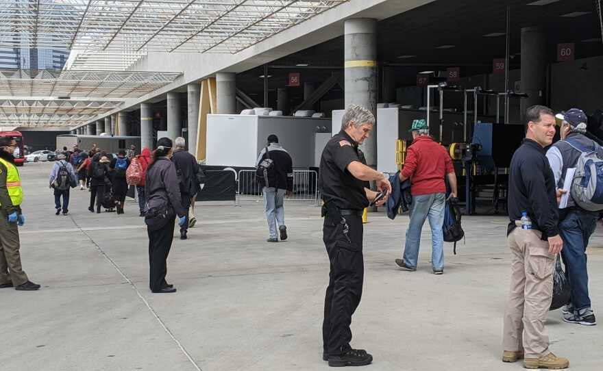 People experiencing homeless being moved into the Convention Center, which is being turned into a temporary shelter during the COVID-19 pandemic, on April 1, 2020.