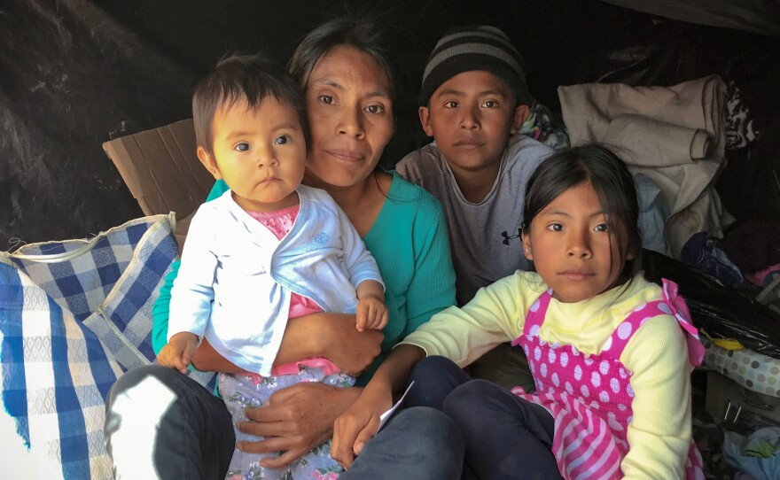 Rosia Ramirez Penaloza and her children fled gang violence in southern Mexico. They're staying in a makeshift tent in San Luis Río Colorado as they wait for a chance to apply for asylum at the port of entry.