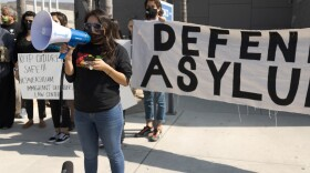 Border Angels Executive Director Dulce Garcia speaks in support of asylum-seekers at the San Ysidro Port-of-Entry on Oct. 21, 2020.
