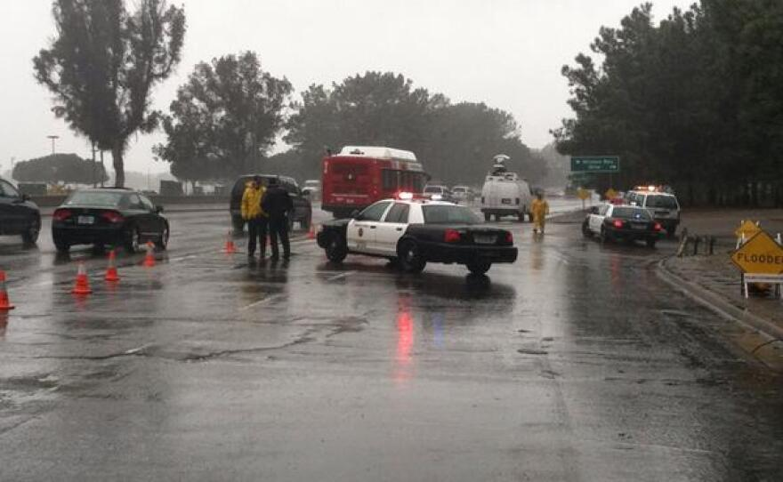 Authorities block of part of Mission Bay Drive due to flooding from heavy rains, Feb. 28, 2014.