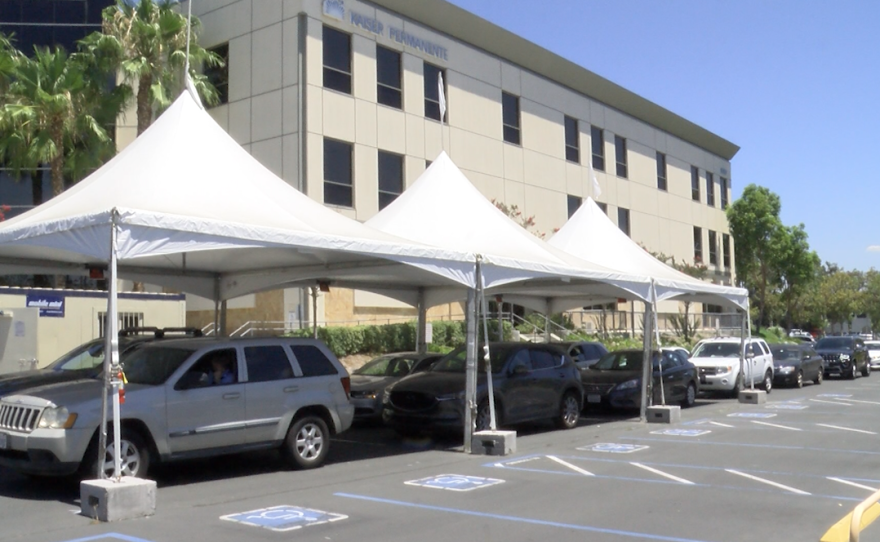 A long line of people in their cars waiting to be tested for COVID-19 in a drive up COVID-19 testing site at the Kaiser Permanente in La Mesa on August 3, 2021.