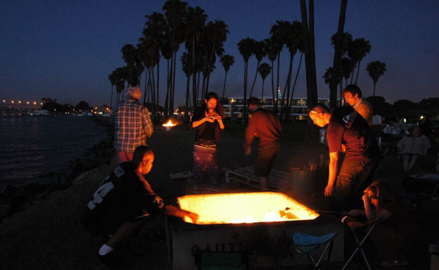 A deal has been reached between San Diego and several tourism and non-profit groups to save the beach fire pits for the coming fiscal year.