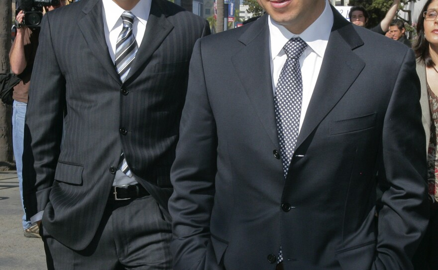 Former California Assembly Speaker Fabian Nunez, right, and his son Esteban Nunez, left, leave a hearing in Superior Court in San Diego, March 18, 2009.