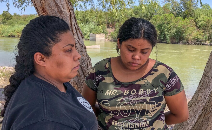 Nora Isabel Gallegos, left, stands with her daughter Priscila Arévalo in the riverside park in Nuevo Laredo, Mexico, where her husband Guillermo was killed by the Border Patrol seven years ago.