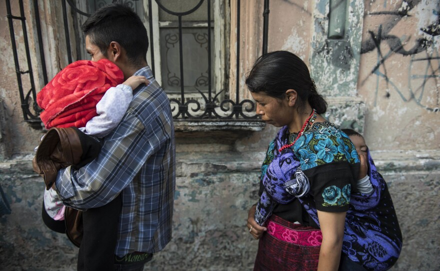 """Nazario Jacinto Carrillo carries his 5-year-old daughter Filomena Jacinto Velasquez, left, after Filomena was returned to her family from the U.S. where she was held by immigration authorities, as they leave the shelter """"Nuestras Raíces"""" where they were reunited in Guatemala City, Tuesday, Aug. 7, 2018."""