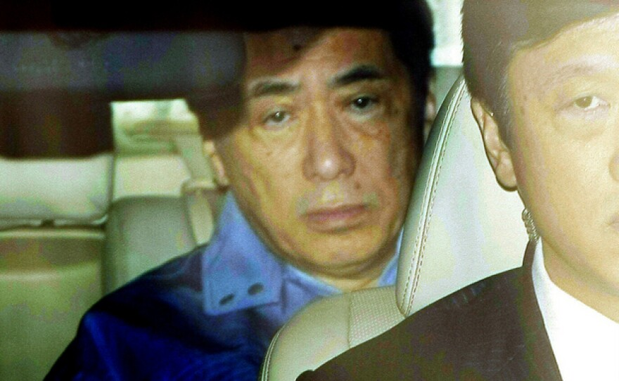 Prime Minister Naoto Kan leaves the headquarters of the Tokyo Electric Power Co. after meeting with the company's staff Tuesday.