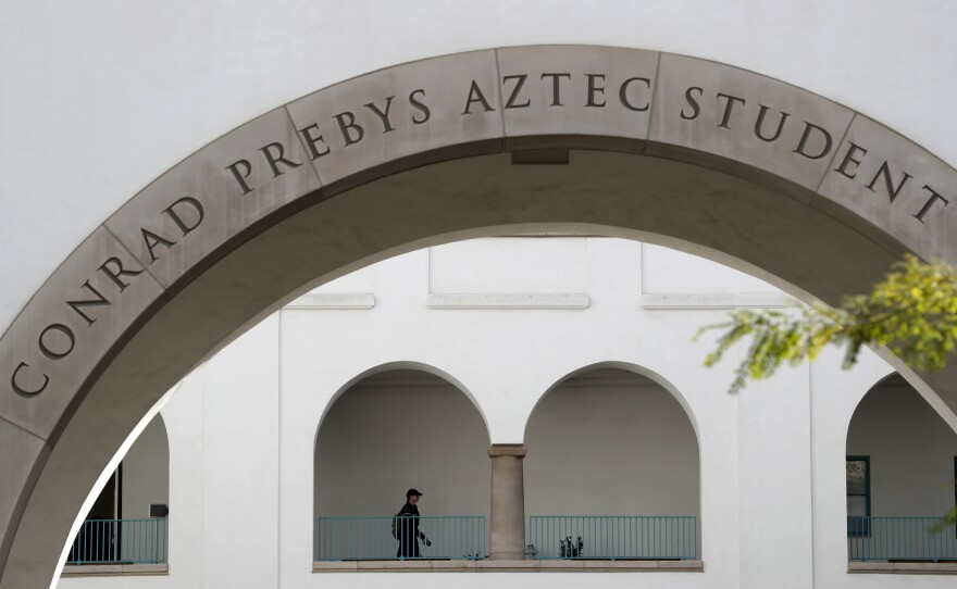 A student walks on the San Diego State University campus Thursday, March 12, 2020, in San Diego.