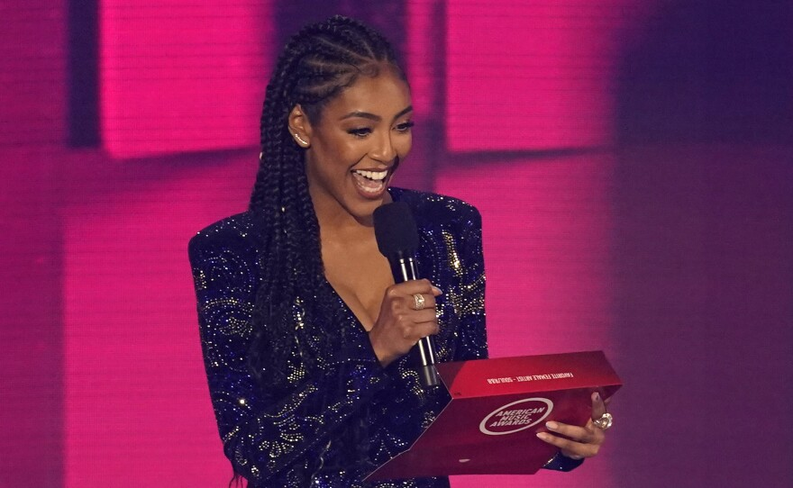 Tayshia Adams appears at the American Music Awards in Los Angeles on Nov. 22, 2020. She will co-host The Bachelorette with Kaitlyn Bristowe, Warner Horizon and ABC Entertainment announced.