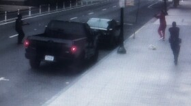 A still of a surveillance camera video from a business released by the San Diego Police Department on June 27, 2020, showing a man pointing his arms at officers before police shot him.