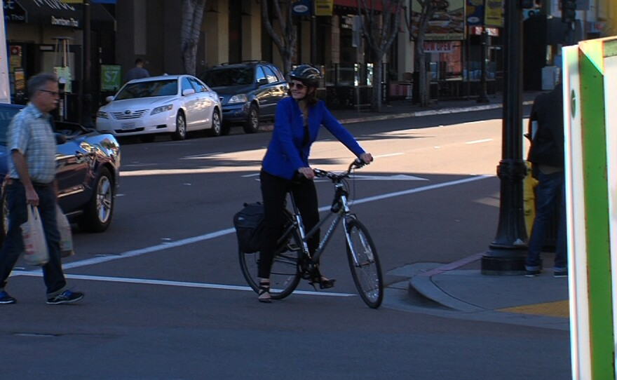 Nicole Capretz, director of the nonprofit Climate Action Campaign, bikes to make a presentation to business groups in the Gaslamp District. February 10, 2015.