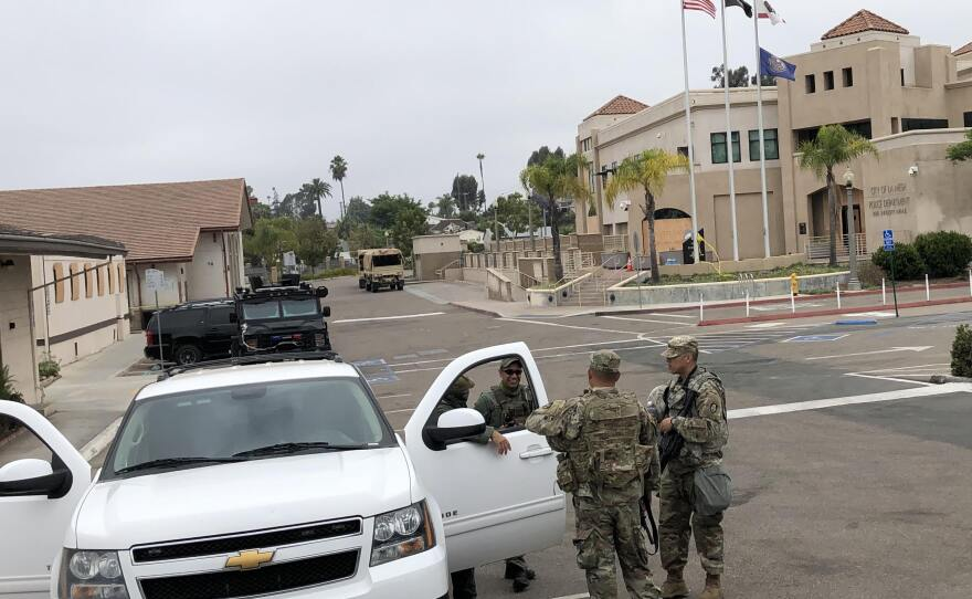 Members of the California National Guard are among the uniformed presence in front of the La Mesa Police station, June 4, 2020.