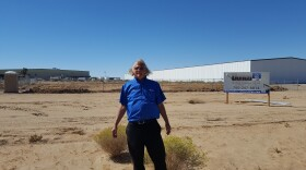 Adelanto City Councilman Johnny Bug Woodard Jr. points to a warehouse in the city's Green Zone that could be used for medical marijuana cultivation.