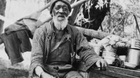 A photo of Nathan Harrison by his Palomar Mountain cabin circa 1916.