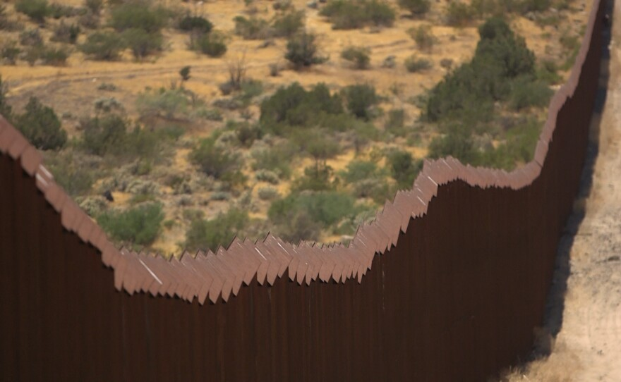 The U.S.-Mexico border fence stretches through southeastern San Diego County, July 13, 2017.