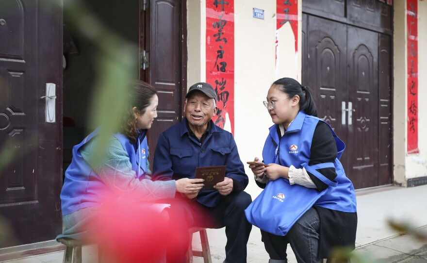 Workers collect demographic data in the the 7th population census on November 1, 2020 in China.