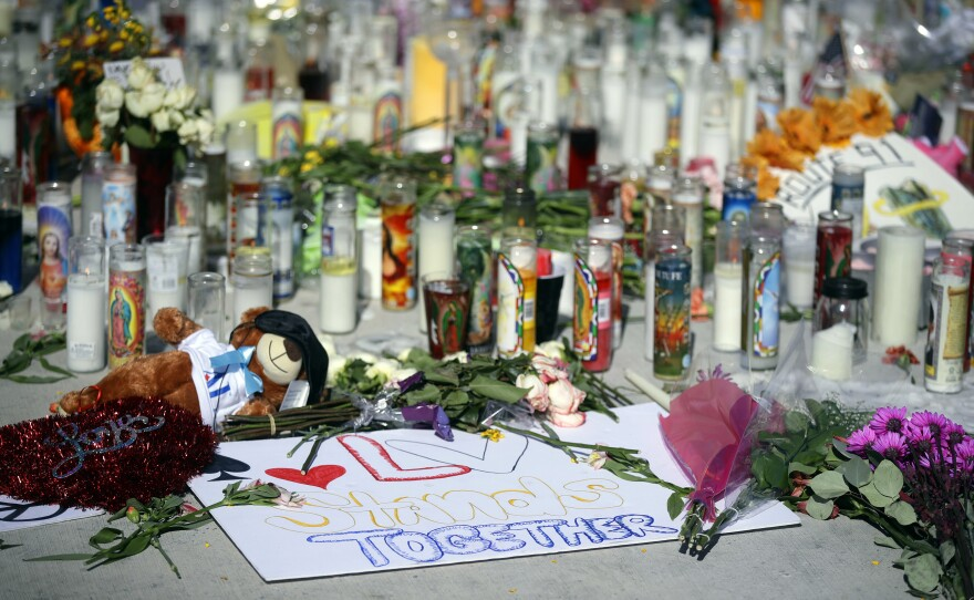 Flowers, candles and toys are left at a makeshift memorial site on Las Vegas Boulevard on Tuesday, Oct. 3, 2017, in Las Vegas.