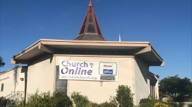 """A sign reading """"Church Online, uchristianchurch.org"""" is hung outside the University Christian Church. The church's website indicates """"all in-person church events have either been canceled or postponed due to precautions surrounding COVID-19."""" Dec. 6, 2020."""