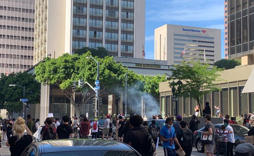 Tear gas canister explodes in a crowd of protesters during a demonstration in downtown San Diego, May 31, 2020.