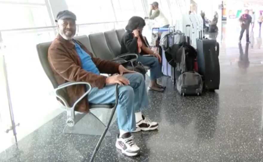 Tourist Milton Howard sits in San Diego's airport after learning his flight was canceled due to a blizzard, Jan. 22, 2016.