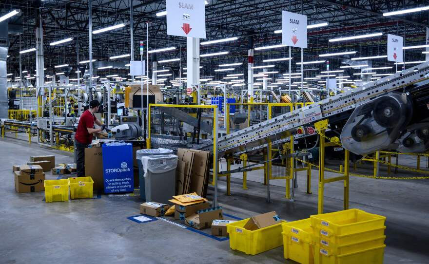 A man works at a conveyor belt at the 855,000-square-foot Amazon warehouse in New York in 2019.
