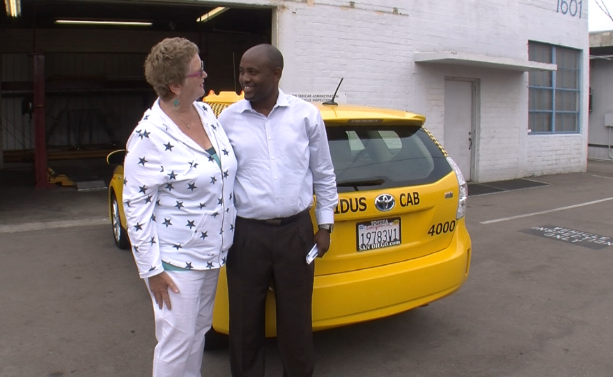 Cabdriver Adane Anjulo thanks San Diego Councilwoman Marti Emerald on July 14, 2015 for her work reforming the taxi industry.