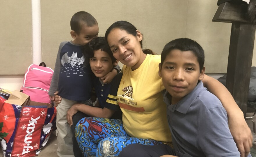 Karen Perez and her three sons wait in a migrant shelter in San Diego, Feb. 13, 2019.