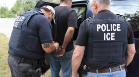 Immigration and Customs Enforcement agents in San Antonio, Texas, take a man into custody as part of an enforcement operation that targeted immigration violators and immigrants who committed crimes in the U.S., Oct. 30, 2014.