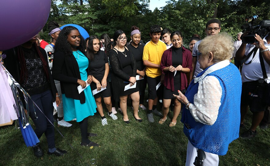 Eva Kor speaks to students at the Newfields' Eva Kor Peace Garden in Indianapolis, Ind.