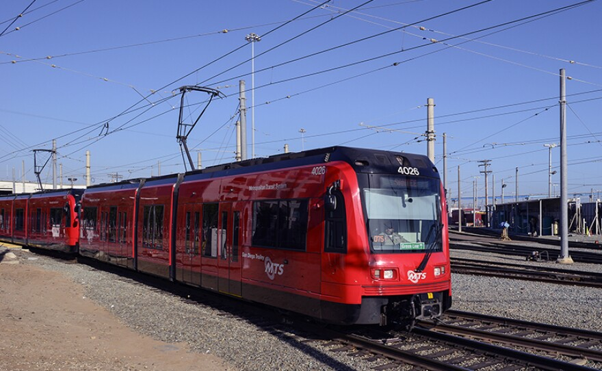 A San Diego trolley pulls out of the downtown stop at 12th Street and Imperial Avenue, June 1, 2014.