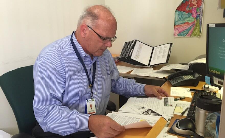 Ed Kirkpatrick, the director of Villa Coronado Skilled Nursing Facility, looks at the file he's complied on 66 Garage.