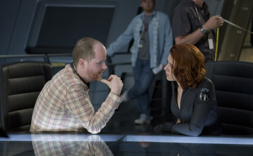 """Our beloved geek king, Joss Whedon, on the set of """"The Avengers"""" with Scarlett Johansson."""