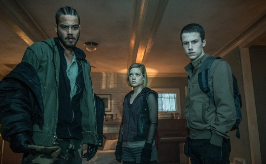 """Money (Daniel Zovatto), Rocky (Jane Levy) and Alex (Dylan Minnette) are three friends who decide to move from petty crime to grand larceny in """"Don't Breathe."""""""
