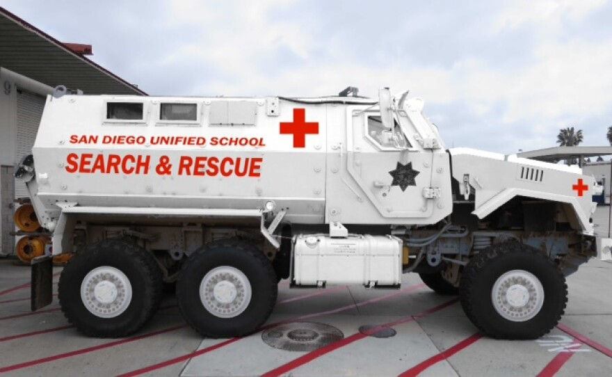 """An """"after"""" image of San Diego Unified School District's MRAP shows the vehicle will be painted white with red crosses."""