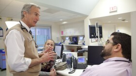 Dr. John Bradley speaks with other physicians at Rady Children's Hospital.