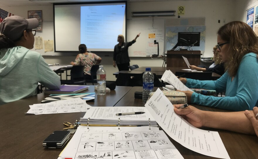 Students in a citizenship class at San Diego Continuing Education's campus in City Heights review worksheets as they learn about the U.S. Constitution, Sept. 14, 2018.