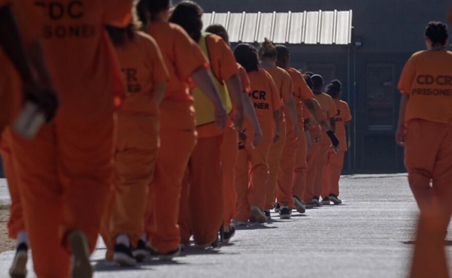 California Department of Corrections & Rehabilitation (CDCR) people in orange.