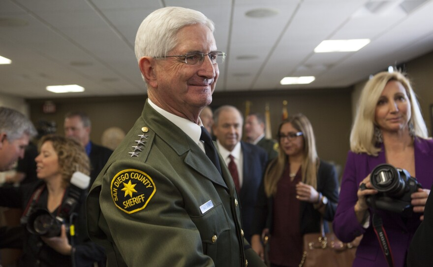 San Diego County Sheriff Bill Gore is shown talking with visitors at the County Administration building in downtown San Diego on Jan. 5, 2015.