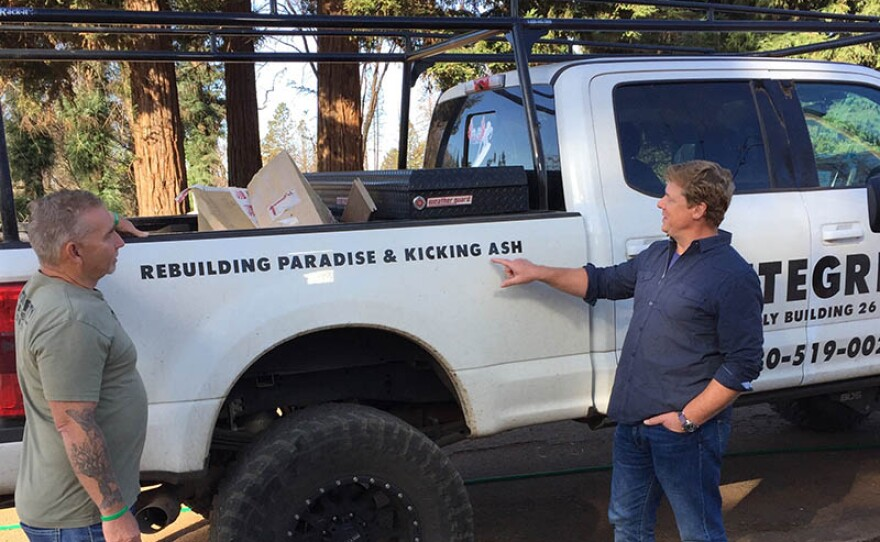 """THIS OLD HOUSE host Kevin O'Connor (right) stands next to a workman's truck with a decal that reads """"Rebuilding Paradise & Kicking Ash."""""""