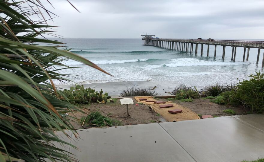 Rain lingers on the horizon behind Scripps Pier, which is where weather balloon launches are happening on Mar. 10, 2020.