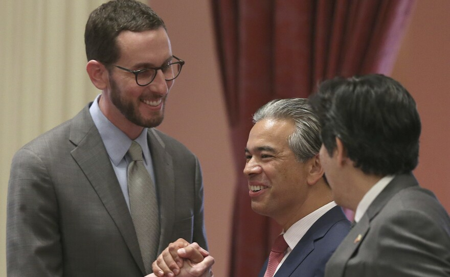 State Sen. Scott Wiener, D-San Francisco, left, receives congratulations from Assemblyman Rob Bonta, D-Alameda, center, and Sen. Kevin de Leon, D-Los Angeles, right, after passage of a bill in Sacramento, Calif. in this undated photo.