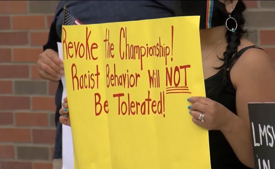 Demonstrators outside Coronado High School calling for the California Interscholastic Federation to revoke Coronado High's regional basketball championship, June 23, 2021.