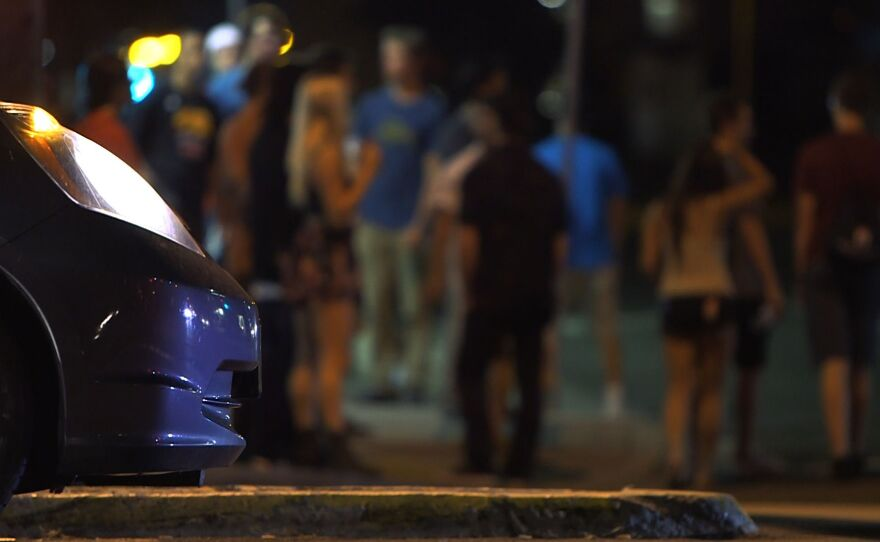 People at Montezuma Road and College Avenue intersection wait for the street lights to change, Aug. 22, 2014.