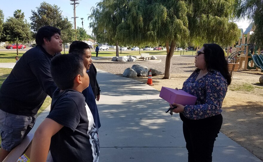 Escondido Councilwoman Consuelo Martinez talks with kids in a local park, June 7, 2019.