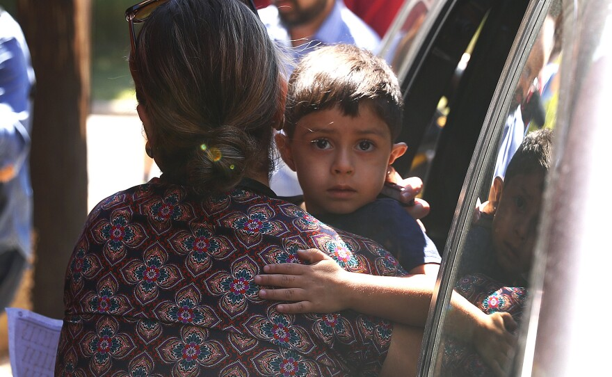 A child from Honduras is brought to the United States Immigration and Customs Enforcement office in Grand Rapids, Mich., Tuesday, July 10, 2018.