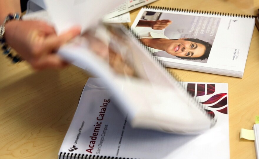 Course catalogs for the University of Phoenix, San Diego are arranged before an audit by the California Department of Veterans Affairs in May.