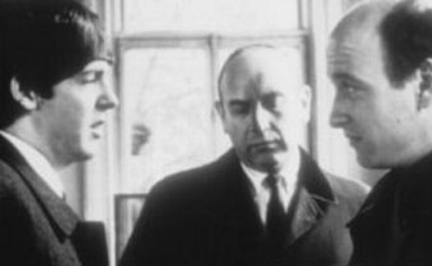 """Paul McCartney on the set of """"A Hard Day's Night"""" with director Richard Lester."""