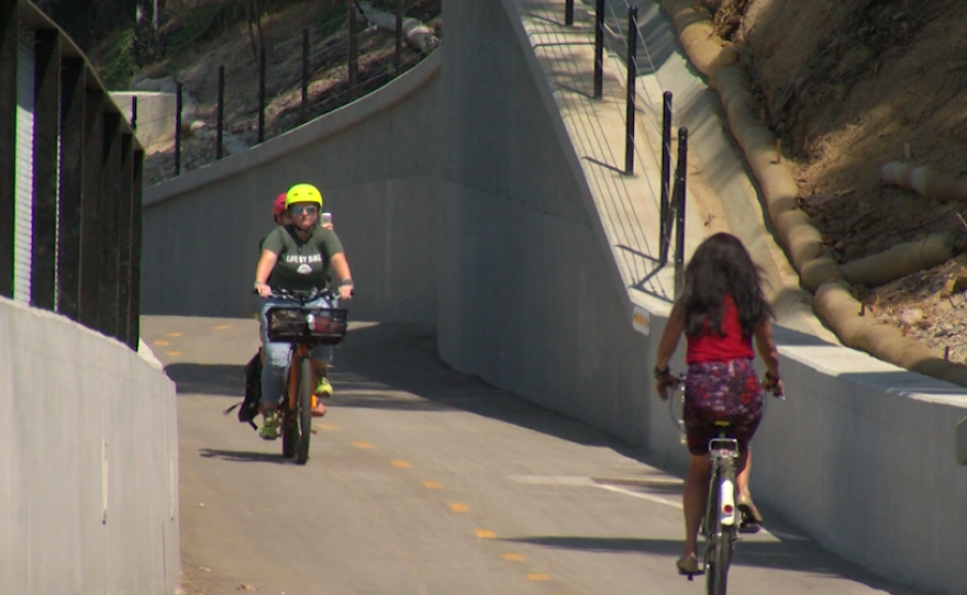 Bicyclists ride on the SR-15 commuter bikeway between Kensington and Mission Valley, Aug. 30, 2017.