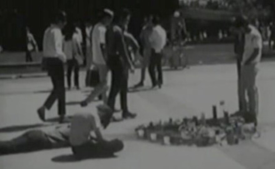 Students surround a makeshift memorial where George Winne committed suicide in protest of the Vietnam War.